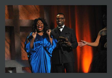 Kim Burrell and VaShawn Mitchell presenting an award