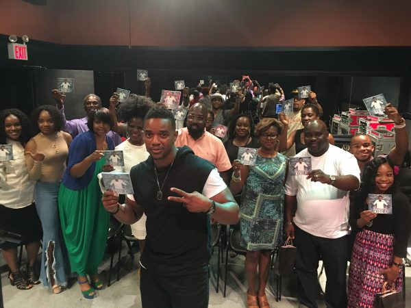 """Some of NYC's media and tastemakers pose with a copy of Pastor Marlon Lock's latest project """"Unleashed"""" at his listening session at the famous SIR Studios in Manhattan. August 15, 2016. Photo courtesy of Root Magazine."""